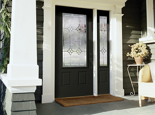 Black front door with half-glass insert with single right sidelite