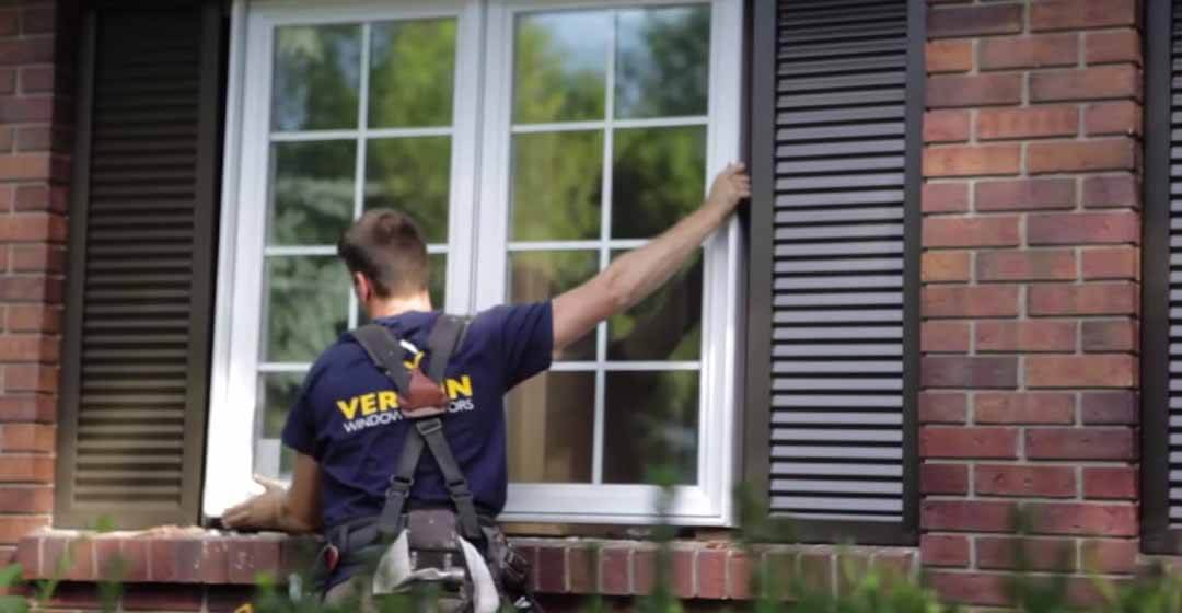A Verdun window installer putting in a replacement, white pvc casement window