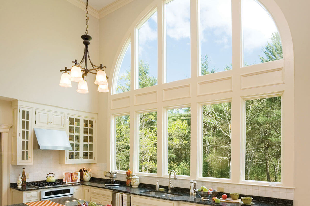 An architectural window in a kitchen letting in plenty of light.