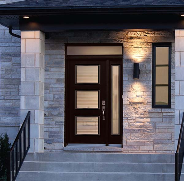 Exterior view of chestnut, modern front door with right sidelite and rectangular transom.