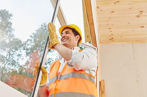 An image of a window installer installing a window.
