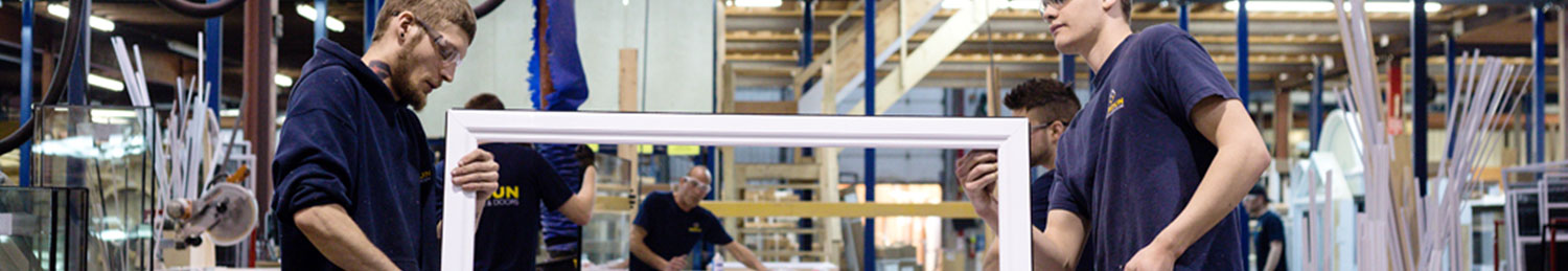 Two Verdun employees assembling a PVC window in Ottawa, ON.