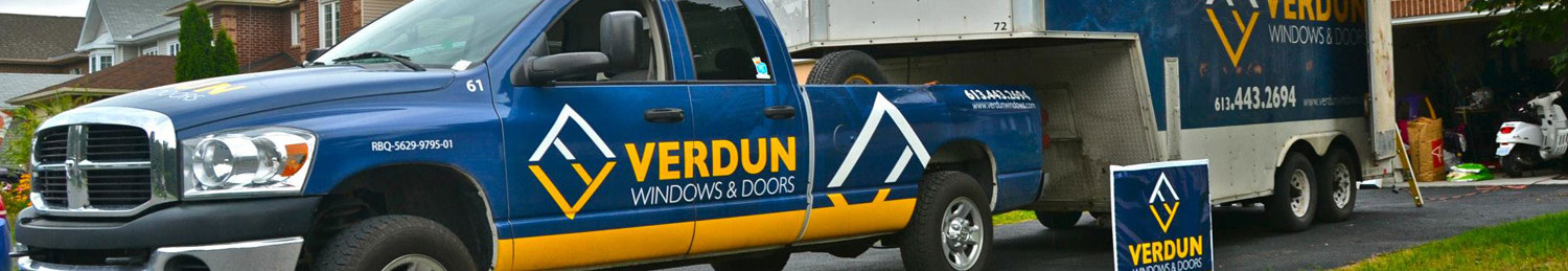 A Verdun truck parked in the driveway of a replacement window client.
