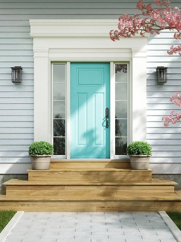 A custom-made teal front door with double sidelites