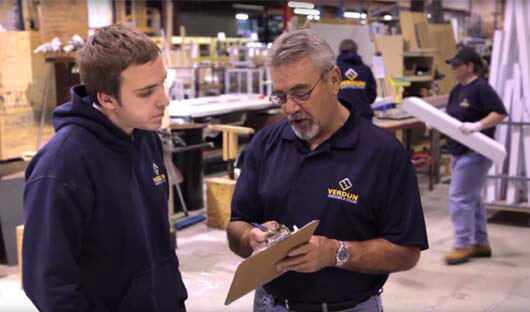 Two Verdun employees talking about the window manufacturing plant in Ottawa