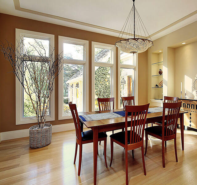 Four replacement casement windows in a dining room